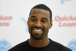 FILE - Detroit Lions wide receiver Calvin Johnson smiles during a press conference at the Grove Hotel in Chandler's Cross, England, in this Wednesday, Oct. 28, 2015, file photo. Johnson was selected Saturday, Feb. 6, 2021, for induction into the Pro Football Hall of Fame's Class of 2021.  (AP Photo/Matt Dunham, File)
