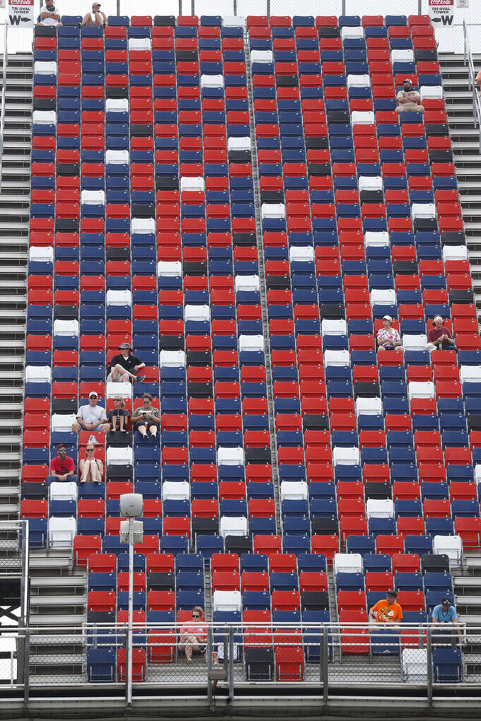 Fans watch a NASCAR Cup Series auto race at Talladega Superspeedway in Talladega Ala., Monday, June 22, 2020. (AP Photo/John Bazemore)