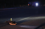"""FILE - In this June 29, 2017 file photo, the body of a man who was shot dead lies on a road in Navolato, on the outskirts of Culiacan, Sinaloa state, Mexico. U.S. officials hailed the conviction of Joaquin """"El Chapo"""" Guzman as a victory for the Mexican people, but in the drug lord's home state of Sinaloa, cradle to his powerful cartel, many residents said they don't expect the violence and trafficking to abate. (AP Photo/Enric Marti, File)"""