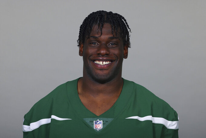 FILE - This is a 2021 file photo of Carl Lawson of the New York Jets NFL football team. Jets star defensive end Carl Lawson was carted off the field Thursday, Aug. 19, 2021, with an apparent leg injury during the team's joint practice with the Green Pay Packers. (AP Photo/File)