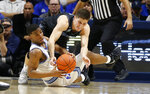 Xavier guard KyKy Tandy, left, and Villanova guard Collin Gillespie, right, fight for a loose ball during the second half of an NCAA college basketball game, Saturday, Feb. 22, 2020, in Cincinnati. (AP Photo/Gary Landers)