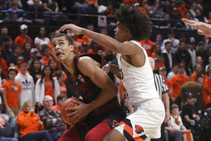 Stanford's Oscar da Silva (13) tries to get past Oregon State's Ethan Thompson during the second half of an NCAA college basketball game in Corvallis, Ore., Thursday, Feb. 7, 2019. Stanford won 83-60. (AP Photo/Amanda Loman)