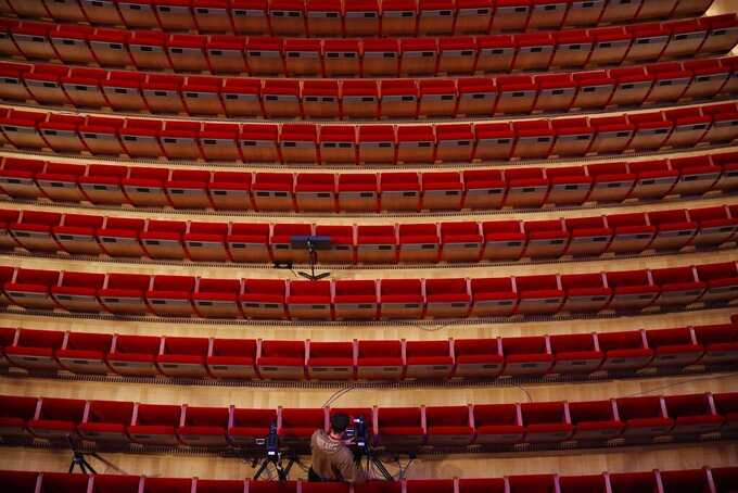 "A cameraman prepares for the video recording of ""Despo-Greek Dances"" Opera and dance performance at the empty Greek National Opera in Athens, Saturday, March 6, 2021. Dozens of museum exhibitions, theater productions, discussion panels and historical re-enactments were planned in Greece for this year to commemorate the bicentennial of the 1821-1832 Greek War of Independence.  But due to the coronavirus pandemic, mezzo-soprano Artemis Bogri and her fellow singers stepped onstage in an empty theater to perform the Greek National Opera's new production of ""Despo,"" one of the events marking 200 years since the war that resulted in Greece's independence from the Ottoman Empire and rebirth as a nation. (AP Photo/Thanassis Stavrakis)"