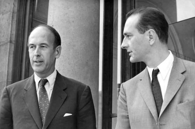 FILE - In this Aug.9 1969, Valery Giscard d'Estaing, left, as Finance Minister and Jacques Chirac as Secretary of State to Finance leave Elysee Palace, Aug. 9, 1969. Valery Giscard d'Estaing, the president of France from 1974 to 1981 who became a champion of European integration, has died Wednesday, Dec. 2, 2020 at the age of 94, his office and the French presidency said. (AP Photo, File)
