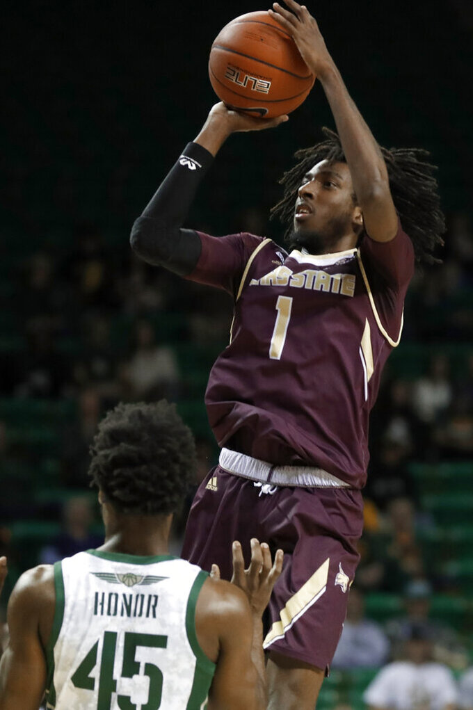 Baylor guard Davion Mitchell (45) defends as Texas State forward Isiah Small (1) shoots during the first half of an NCAA college basketball game in Waco, Texas, Friday, Nov. 15, 2019. (AP Photo/Tony Gutierrez)
