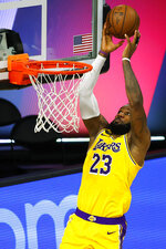 Los Angeles Lakers' LeBron James goes up for a shot against the Sacramento Kings during the second quarter of an NBA basketball game Thursday, Aug. 13, 2020, in Lake Buena Vista, Fla. (Kevin C. Cox/Pool Photo via AP)