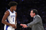 Duke coach Mike Krzyzewski talks with center Vernon Carey Jr. during the second half of the team's NCAA college basketball game against Kansas on Tuesday, Nov. 5, 2019, in New York. (AP Photo/Adam Hunger)