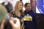 Mikaela Shiffrin poses for photographs with fans at Macy's Thursday, March 21, 2019, in New York. The 24-year-old American spent time in New York to celebrate an unprecedented 17 World Cup wins and her third straight overall title.(AP Photo/Frank Franklin II)