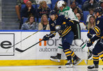 Buffalo Sabres forward Sam Reinhart (23) and Dallas Stars forward Roope Hintz (24) collide during the second period of an NHL hockey game, Monday, Oct. 14, 2019, in Buffalo N.Y. (AP Photo/Jeffrey T. Barnes)