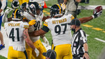 Pittsburgh Steelers defensive tackle Cameron Heyward (97) celebrates with teammates after a turnover by the New York Giants during the third quarter of an NFL football game Monday, Sept. 14, 2020, in East Rutherford, N.J. (AP Photo/Seth Wenig)