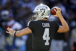 Oakland Raiders quarterback Derek Carr looks to throw during the second half of an NFL football game against the Cincinnati Bengals in Oakland, Calif., Sunday, Nov. 17, 2019. (AP Photo/Ben Margot)