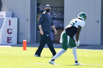 New York Jets head coach Adam Gase looks over his team during practice at the NFL football team's training camp in Florham Park, N.J., Thursday, Aug. 20, 2020. (AP Photo/Seth Wenig)