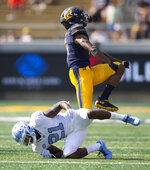 California's Elijah Hicks (3) celebrates breaking up a pass intended for North Carolina wide receiver Dyami Brown (21) during the second half of an NCAA college football game, Saturday, Sept. 1, 2018, in Berkeley, Calif. Cal won 24-17. (AP Photo/D. Ross Cameron)