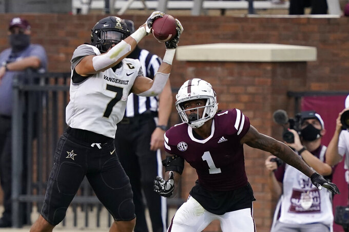 Vanderbilt wide receiver Cam Johnson (7) pulls down a pass in front of Mississippi State cornerback Martin Emerson (1) during the first half of an NCAA college football game in Starkville, Miss., Saturday, Nov. 7, 2020. (AP Photo/Rogelio V. Solis)