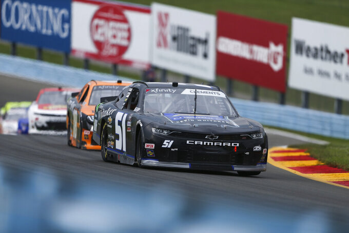 Jeremy Clements (51) drives through the Esses in the NASCAR Xfinity Series auto race at Watkins Glen International in Watkins Glen, N.Y., on Saturday, Aug. 7, 2021. (AP Photo/Joshua Bessex)