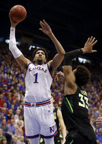 Kansas' Dedric Lawson (1) gets past Baylor's Freddie Gillespie (33) to put up a shot during the first half of an NCAA college basketball game Saturday, March 9, 2019, in Lawrence, Kan. (AP Photo/Charlie Riedel)