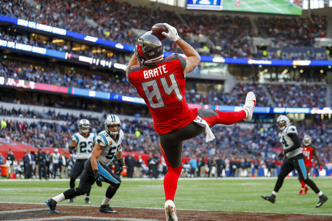 Tampa Bay Buccaneers tight end Cameron Brate (84) makes a touchdown catch against the Carolina Panthers during the fourth quarter of an NFL football game, Sunday, Oct. 13, 2019, at Tottenham Hotspur Stadium in London. (AP Photo/Alastair Grant)