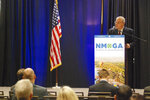 U.S. Interior Secretary David Bernhardt, right, describes deregulation efforts by the Trump administration at an annual meeting of the New Mexico Oil and Gas Association in Santa Fe, N.M., Tuesday, Oct. 8, 2019. U.S. Bernhardt cited a moratorium on new oil permits in New Mexico near a national park held sacred by Native Americans as an example of balanced federal regulation, while warning against Green New Deal policies. New Mexico is reforming its oversight of greenhouse gas emissions at oil and gas installations. (AP Photo/Morgan Lee)