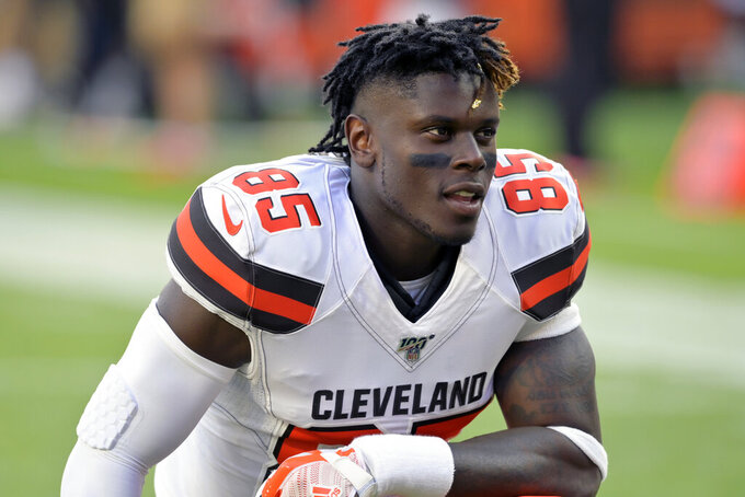 FILE - In this Aug. 8, 2019, file photo, Cleveland Browns tight end David Njoku kneels on the field before an NFL preseason football game against the Washington Redskins, in Cleveland. The Browns could be missing several starters Sunday night when they face the defending NFC champion Los Angeles Rams. Tight end David Njoku (wrist), linebacker Christian Kirksey (chest), right tackle Chris Hubbard (foot) and safeties Damarious Randall (concussion) and Morgan Burnett (leg) missed practice Thursday, Sept. 19, 2019. (AP Photo/David Richard, File)