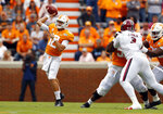 Tennessee quarterback J.T. Shrout (12) throws to receiver in the first half of an NCAA college football game against South Carolina, Saturday, Oct. 26, 2019, in Knoxville, Tenn. (AP Photo/Wade Payne)