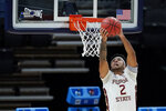 Florida State's Anthony Polite (2) dunks during the second half of a first-round game against UNC-Greensboro in the NCAA men's college basketball tournament at Banker's Life Fieldhouse, Saturday, March 20, 2021, in Indianapolis. Florida State defeated UNC-Greensboro 64-54. (AP Photo/Darron Cummings)