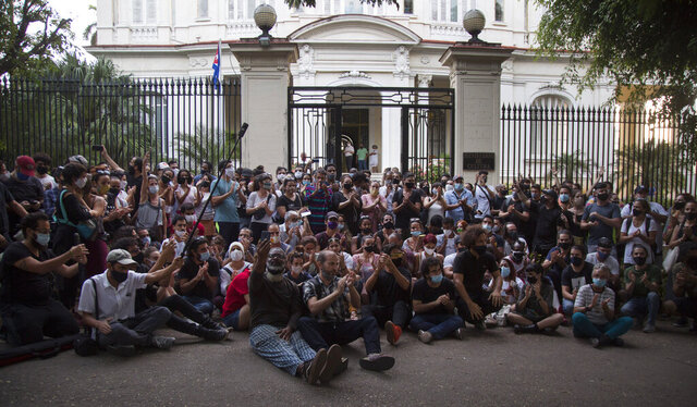 Young artists protest in front of the doors of the Ministry of Culture, in Havana, Cuba, Friday, Nov. 27, 2020. Dozens of Cuban artists demonstrated against the police evicting a group who participated in a hunger strike. (AP Photo/Ismael Francisco)