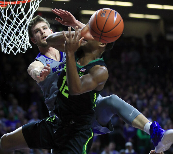 Kansas State forward Dean Wade, back, covers Baylor guard Jared Butler (12) during the first half of an NCAA college basketball game in Manhattan, Kan., Saturday, March 2, 2019. (AP Photo/Orlin Wagner)