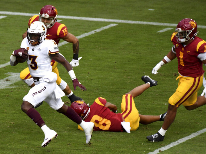 Running back Rachaad White #3 of the Arizona State Sun Devils runs for a touch down against safety Talanoa Hufanga #15 of the USC Trojans in the first half of a NCAA football game at the Los Angeles Memorial Coliseum in Los Angeles on Saturday, November 7, 2020. (Keith Birmingham/The Orange County Register via AP)