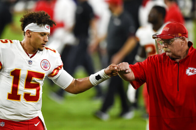 Kansas City Chiefs quarterback Patrick Mahomes (15) and head coach Andy Reid bump fists after an NFL football game against the Baltimore Ravens, Monday, Sept. 28, 2020, in Baltimore. The Chiefs won 34-20. (AP Photo/Gail Burton)