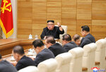 In this April 9, 2019, photo provided by the North Korean government, North Korean leader Kim Jong Un addresses the Political Bureau of the Central Committee of the ruling Workers' Party of Korea in Pyongyang. North Korea's Supreme People's Assembly is expected to formally approve leader Kim's latest economic policies and possibly endorse a shift in U.S. strategy following his failed summit with President Donald Trump in Hanoi. The assembly is to convene on Thursday, April 11. Independent journalists were not given access to cover the event depicted in this image distributed by the North Korean government. The content of this image is as provided and cannot be independently verified. Korean language watermark on image as provided by source reads: