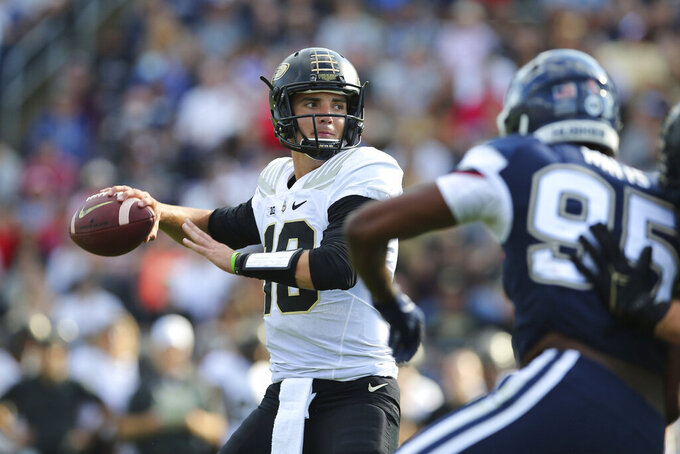 Purdue quarterback Jack Plummer (13) throws a touchdown pass during the first half of an NCAA football game against Connecticut on Saturday, Sept. 11, 2021, in East Hartford, Conn. (AP Photo/Stew Milne)
