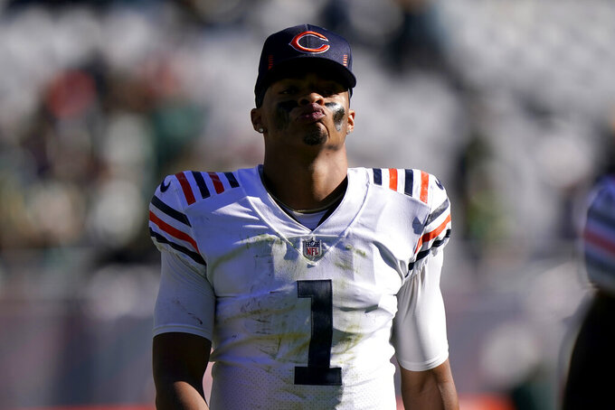 Chicago Bears quarterback Justin Fields walks off the field after his team's 24-14 loss to the Green Bay Packers in an NFL football game Sunday, Oct. 17, 2021, in Chicago. (AP Photo/Nam Y. Huh)