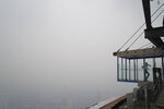 A staff waits at Skybox at Kuala Lumpur Tower as city stands shrouded with haze in Kuala Lumpur, Malaysia, Friday, Sept. 13, 2019. Malaysian authorities plan to conduct cloud-seeding activities to induce rain to ease the haze. The government said it will press Jakarta to take immediate action to put out the burning forests and ensure the fires won't occur again. (AP Photo/Vincent Thian)