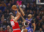 Sacramento Kings forward Nemanja Bjelica, left, goes up to shoot against New York Knicks forward Taj Gibson, right, during the first quarter of an NBA basketball game in Sacramento, Calif., Friday, Dec. 13, 2019. (AP Photo/Rich Pedroncelli)