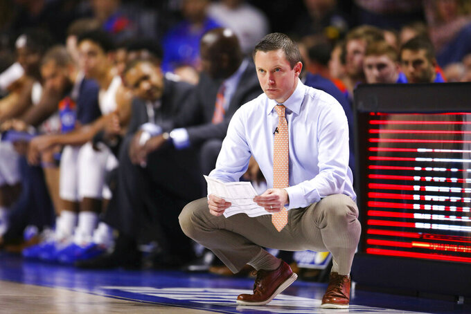 FILE - In this Feb. 2, 2019, file photo, Florida coach Mike White watches during the second half of an NCAA college basketball game against Kentucky in Gainesville, Fla. Florida is limping into the postseason, having lost three straight, and probably needs at least one win in the SEC Tournament to get to the NCAAs for a third straight year. (AP Photo/Matt Stamey, File)