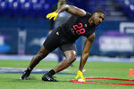 Florida defensive lineman Jonathan Greenard runs a drill at the NFL football scouting combine in Indianapolis, Saturday, Feb. 29, 2020. (AP Photo/Michael Conroy)