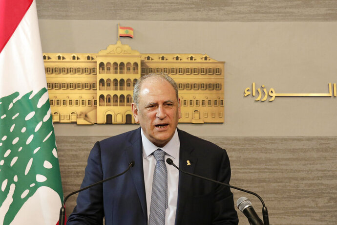 Lebanese Information Minister Jamal Jarrah speaks to journalist at the Government House in Beirut, Lebanon, Friday, May 24, 2019. Jarrah says the government has agreed on a 2019 budget, wrapping up weeks of haggling over an austerity budget that aims to cut public spending and reduce the deficit. (AP Photo/Hassan Ammar)