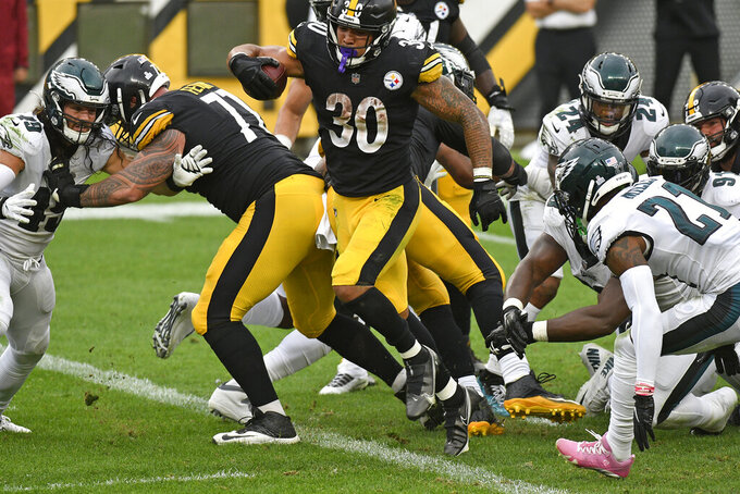 Pittsburgh Steelers running back James Conner (30) scores on a 1-yard run during the second half of an NFL football game against the Philadelphia Eagles in Pittsburgh, Sunday, Oct. 11, 2020. (AP Photo/Don Wright)