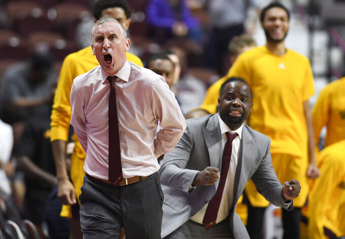 Arizona State head coach Bobby Hurley, left, and associate head coach Rashon Burno react to a call during the second half of an NCAA college basketball game against St. John's, Saturday, Nov. 23, 2019, in Uncasville, Conn. (AP Photo/Jessica Hill)