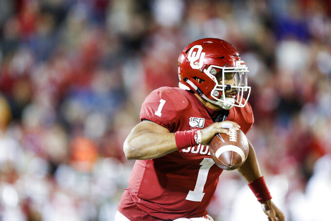 Oklahoma Sooners quarterback Jalen Hurts (1) attempts a pass during the NCAA football game between the against the Iowa State Cyclones and the Oklahoma Sooners at Gaylord Family-Oklahoma Memorial Stadium in Norman, Okla., on Saturday, Nov. 9, 2019. (Ian Maule/Tulsa World via AP)