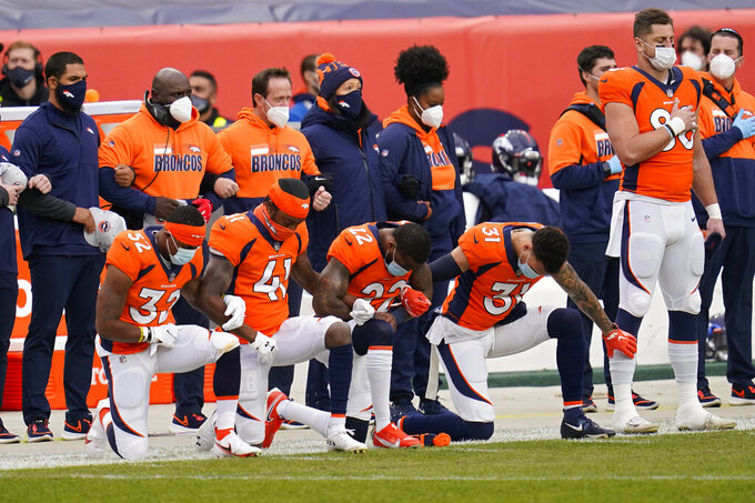 Denver Broncos players kneel during the national anthem before an NFL football game against the Las Vegas Raiders, Sunday, Jan. 3, 2021, in Denver. (AP Photo/David Zalubowski)
