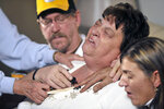 FILE - In this Feb. 23, 2009, file photo, Jack Houk, left, and Deborah Houk, center, the parents of deceased Kenzie Houk, react during a news conference from their home in New Galilee, Pa. Jordan Brown, who was eleven-years-old at the time, was charged in the shooting death of the 26-year-old pregnant mother of two. On Wednesday, July 1, 2020, Brown and his attorneys filed a wrongful prosecution and conviction lawsuit, alleging that state police investigators manipulated interviews, evidence and procedures to push the narrative that Brown had killed his soon-to-be stepmom. (Christina Baird/Beaver County Times via AP, File)