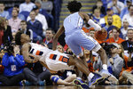 Syracuse forward Elijah Hughes falls after coming into contact with North Carolina guard Leaky Black (1) during the first half of an NCAA college basketball game at the Atlantic Coast Conference tournament in Greensboro, N.C., Wednesday, March 11, 2020. (AP Photo/Gerry Broome)