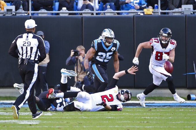 Atlanta Falcons quarterback Matt Ryan (2) loses the ball during a conversion attempt following a touchdown against the Carolina Panthers during the second half of an NFL football game in Charlotte, N.C., Sunday, Nov. 17, 2019. (AP Photo/Mike McCarn)