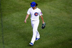 Chicago Cubs starting pitcher Yu Darvish walks off the field after being removed during the seventh inning in Game 2 of a National League wild-card baseball series against the Miami Marlins Friday, Oct. 2, 2020, in Chicago. (AP Photo/Nam Y. Huh)