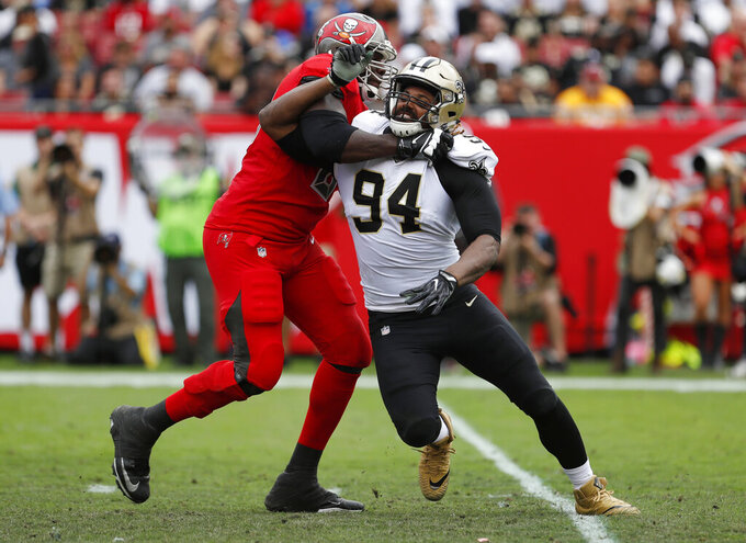 FILE - In this Dec. 9, 2018, file photo, New Orleans Saints defensive end Cameron Jordan (94) works against a Tampa Bay Buccaneers player during the first half of an NFL football game in Tampa, Fla. A person familiar with the situation says Jordan, who has been New Orleans' sack leader in six of the past seven seasons, has agreed to a three-year extension worth up to $55.5 million. The person spoke to The Associated Press on condition of anonymity on Tuesday, June 11, 2019, because the extension, which follows the two years left on his current contract and runs through 2023, is not expected to be signed until Wednesday and has not been announced. (AP Photo/Mark LoMoglio, File)