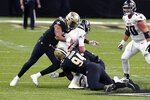 Atlanta Falcons quarterback Matt Ryan is sacked by New Orleans Saints defensive end Cameron Jordan (94) and defensive end Marcus Davenport, musing the Flacons out of field goal range, in the first half of an NFL football game in New Orleans, Sunday, Nov. 22, 2020. (AP Photo/Butch Dill)