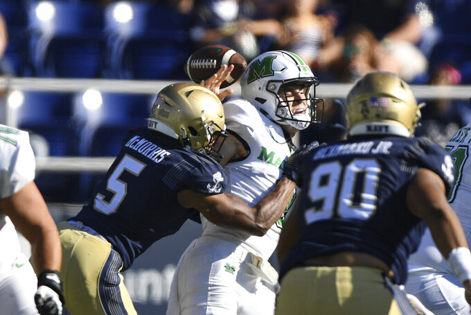 Marshall quarterback Grant Wells is sacked by Navy cornerback Michael McMorris (5) during the first half of an NCAA college football game, Saturday, Sept. 4, 2021, in Annapolis, Md. (AP Photo/Terrance Williams)