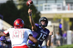 Northwestern quarterback Hunter Johnson (15) passes away from UNLV defensive lineman Nate Neal (91) during the first half of an NCAA college football game, Saturday, Sept. 14, 2019, in Evanston, Ill. (AP Photo/Matt Marton)