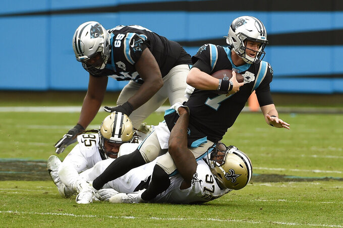 New Orleans Saints defensive end Mario Edwards (97) sacks Carolina Panthers quarterback Kyle Allen (7) during the second half of an NFL football game in Charlotte, N.C., Sunday, Dec. 29, 2019. (AP Photo/Mike McCarn)